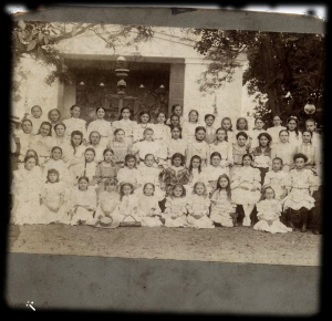 Emma and Tessy in school: Emma standing last row fourth from right, Tessy sitting second row second from left
