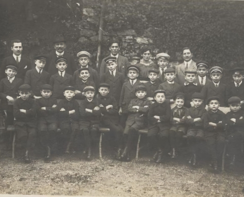 Karl in Kinderheim: Sitting (and smiling) fifth from right (1921)